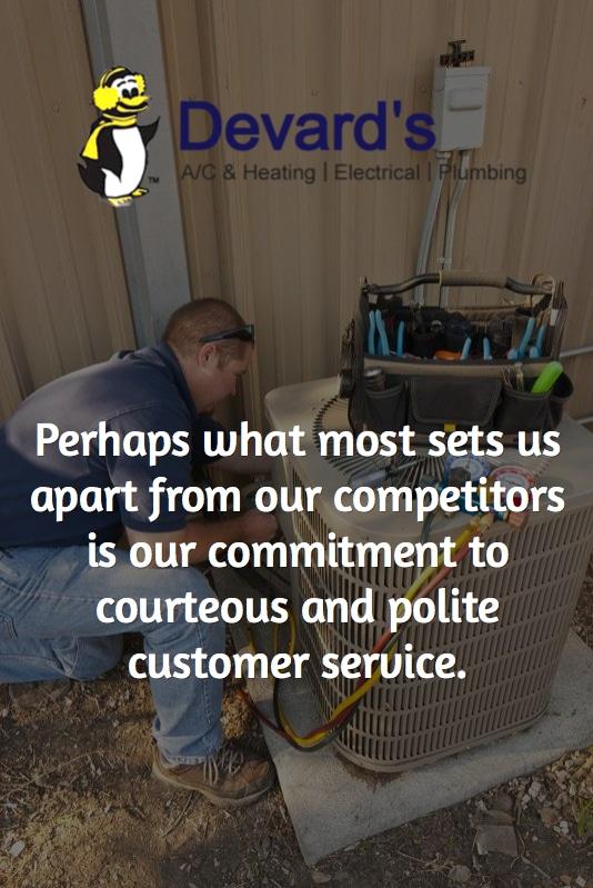 HVAC technician repairing an air conditioning unit