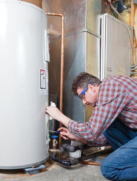Plumber replacing water heater
